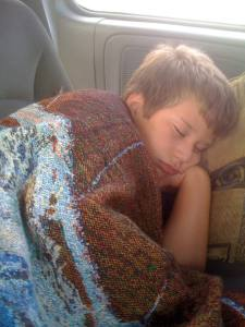 Mancub at age 10 sleeping on the way home from Arkansas.